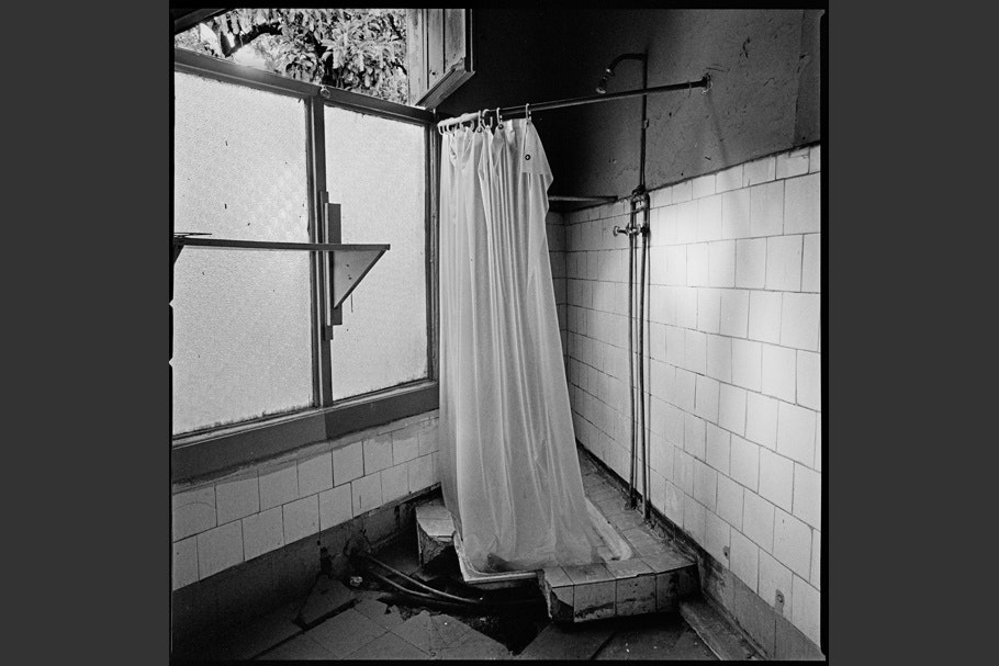 Broken shower in a former detention and torture center