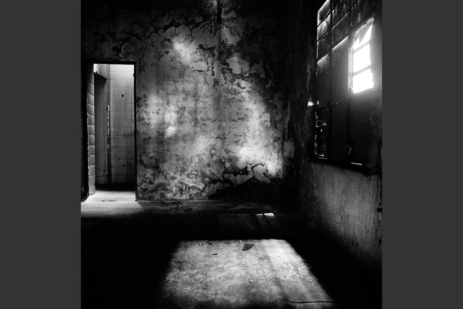 Light illuminating the interior of a former torture room