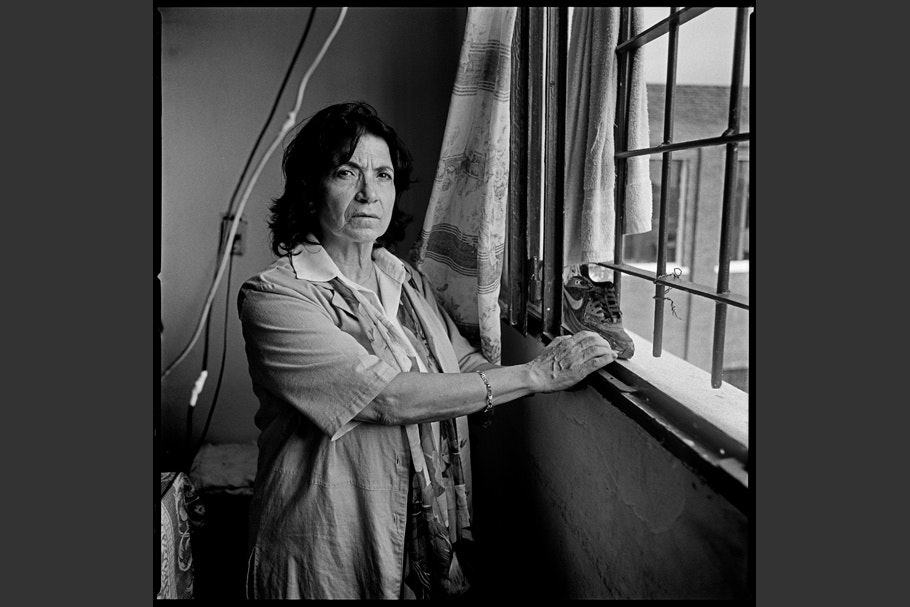 Portrait of a woman standing by a window