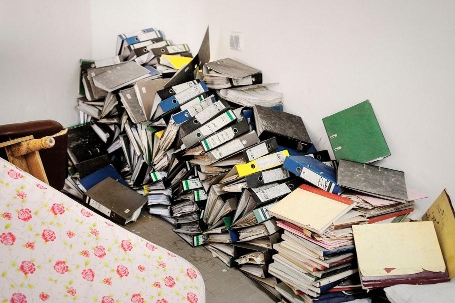 Pile of binders on the floor