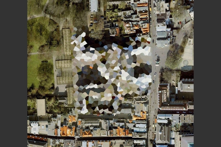 Google Earth image of landscape with colored, irregular-shaped pattern in center