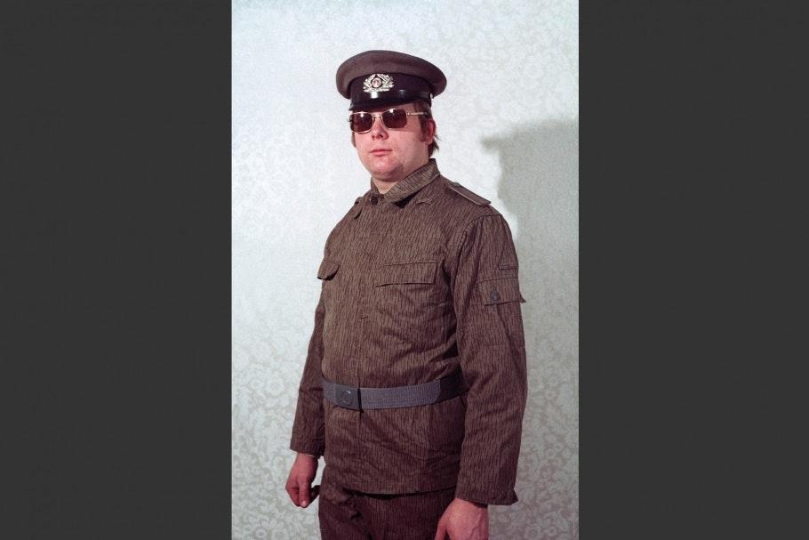 Man in uniform wearing sunglasses