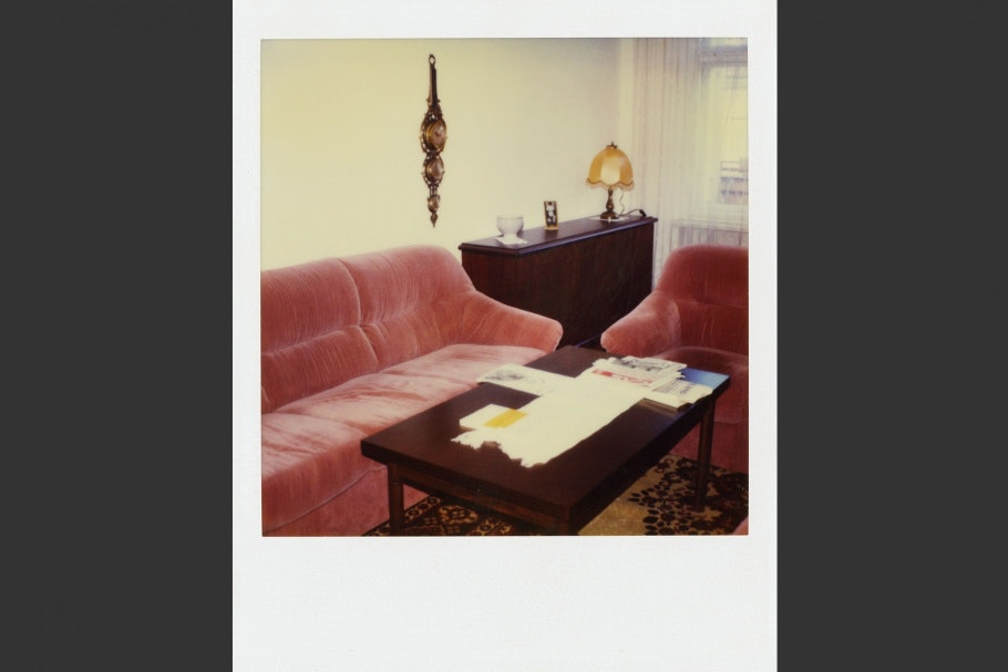 Living room with pink velvet couches and coffee table