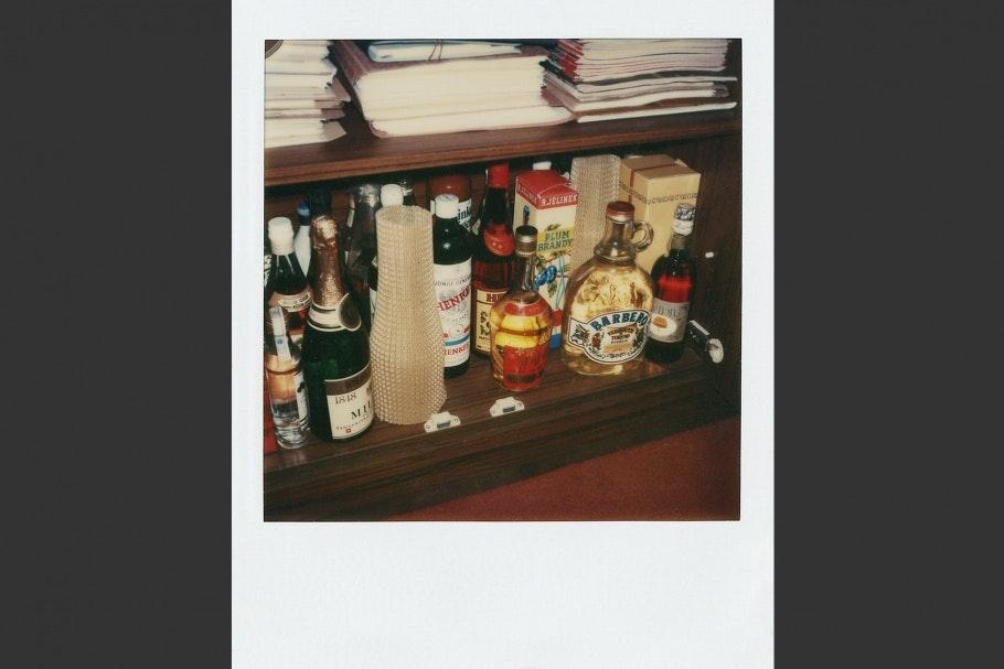 Shelf with bottles of liquor