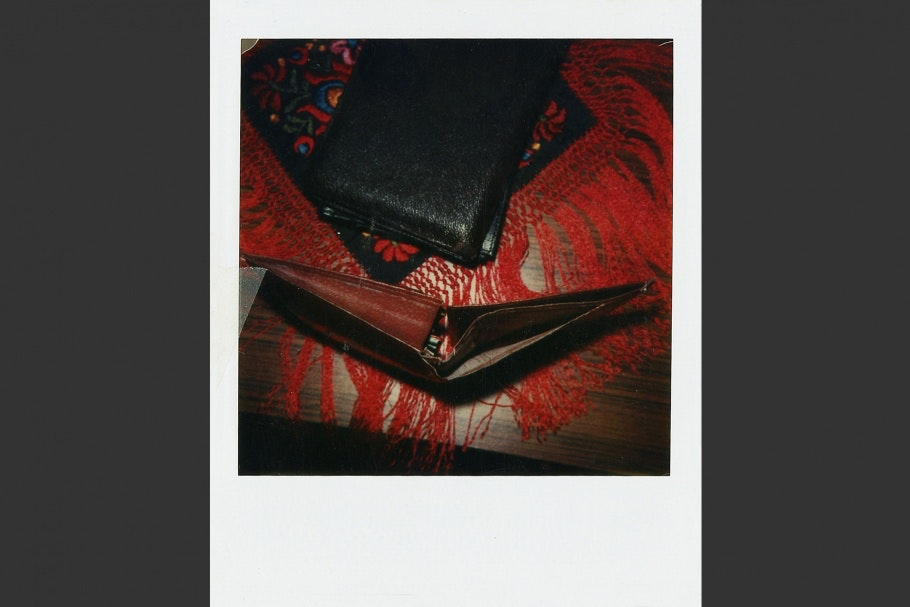 Two leather wallets—one black and one brown—on table