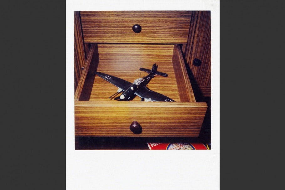 Open drawer with toy airplane