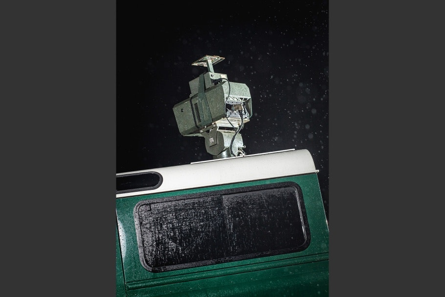 Close-up of thermal imagining camera mounted atop a green vehicle