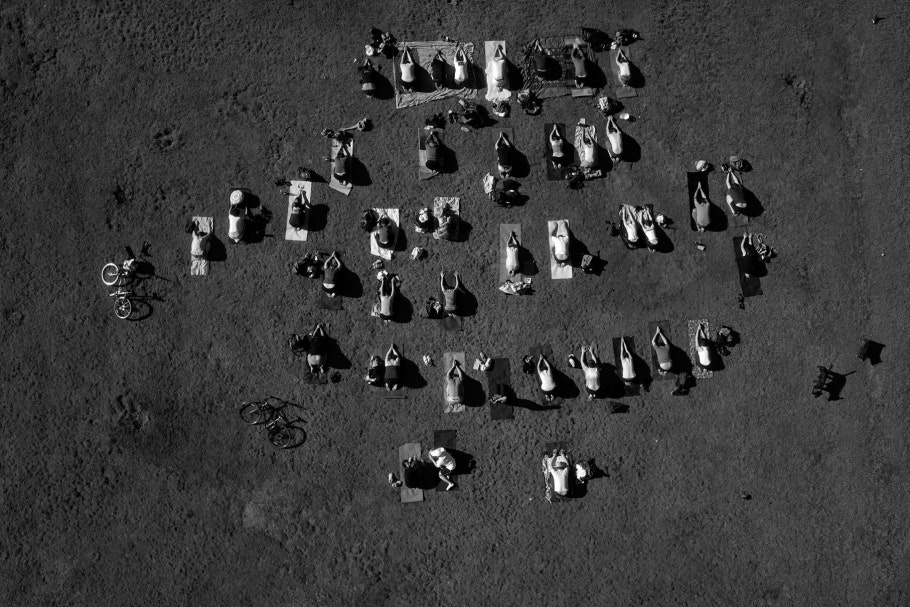 Aerial photograph of a public park with yoga practitioners