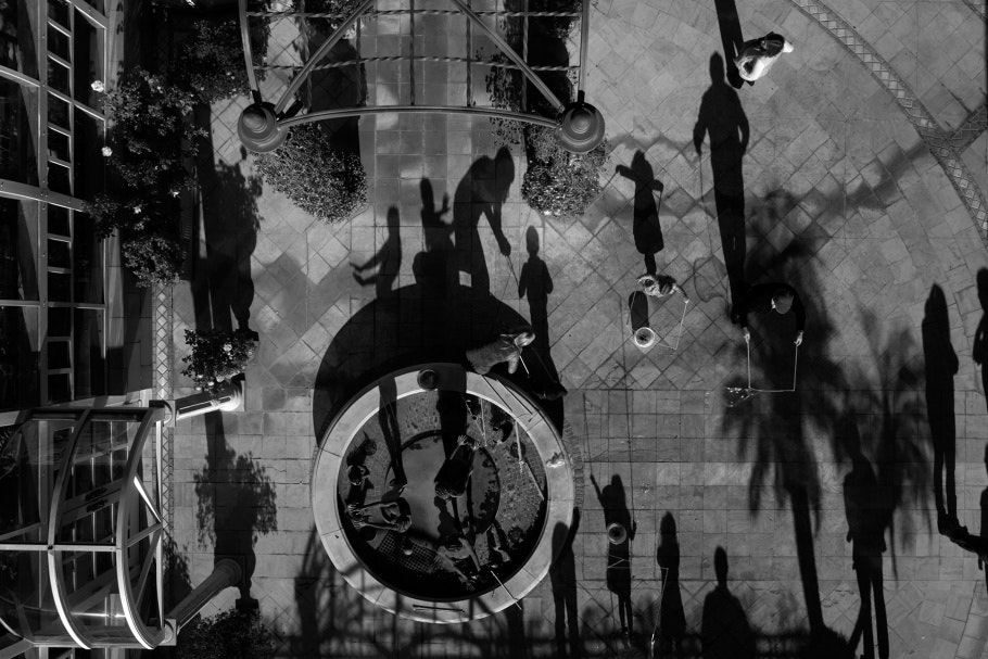 Aerial photograph of children playing and scattered throughout open courtyard