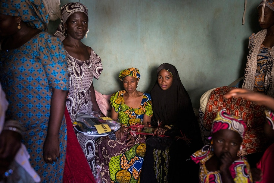 Women sit in a room at a wedding celebration in Kano, Nigeria