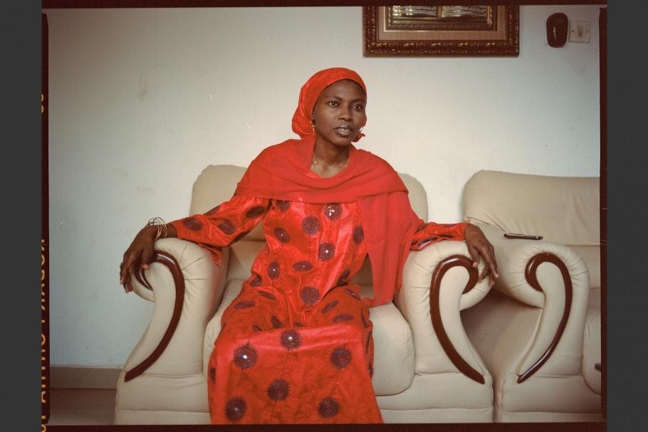 A Nigerian romance novelist sits for a portrait