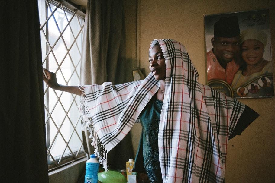 A Nigerian romance novelist stands for a portrait