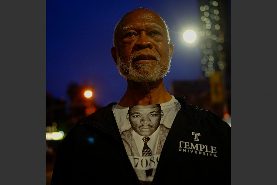 A man wearing a shirt of Martin Luther King Jr.