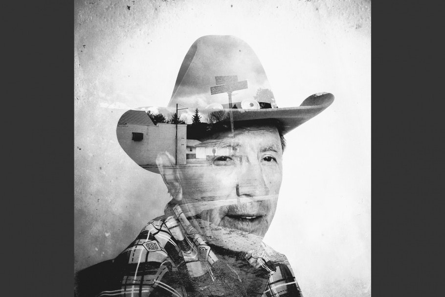 A street superimposed on a man wearing a cowboy hat.