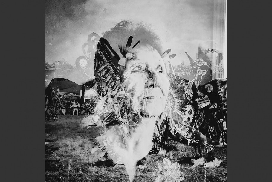 A picture of Native Americans in a yard superimposed over a woman's face.