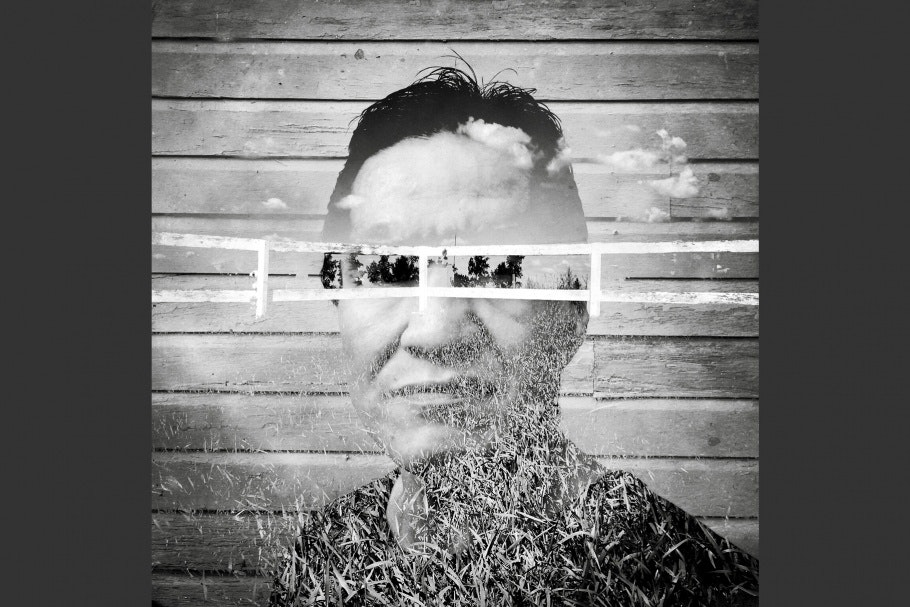 A fence superimposed on a person's face.