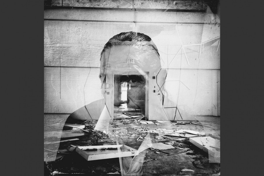 A dilapidated room superimposed on a man's face.
