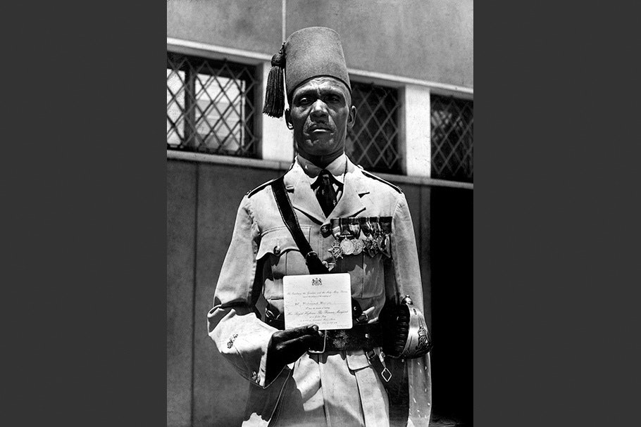 Nubian officer holding an invitation.
