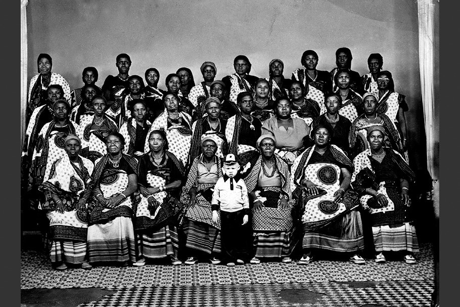 A large group of women posing for a photo.