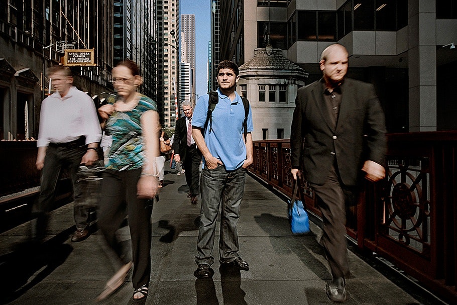 People walking on a bridge.