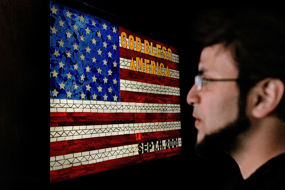 Man in front of an American flag.