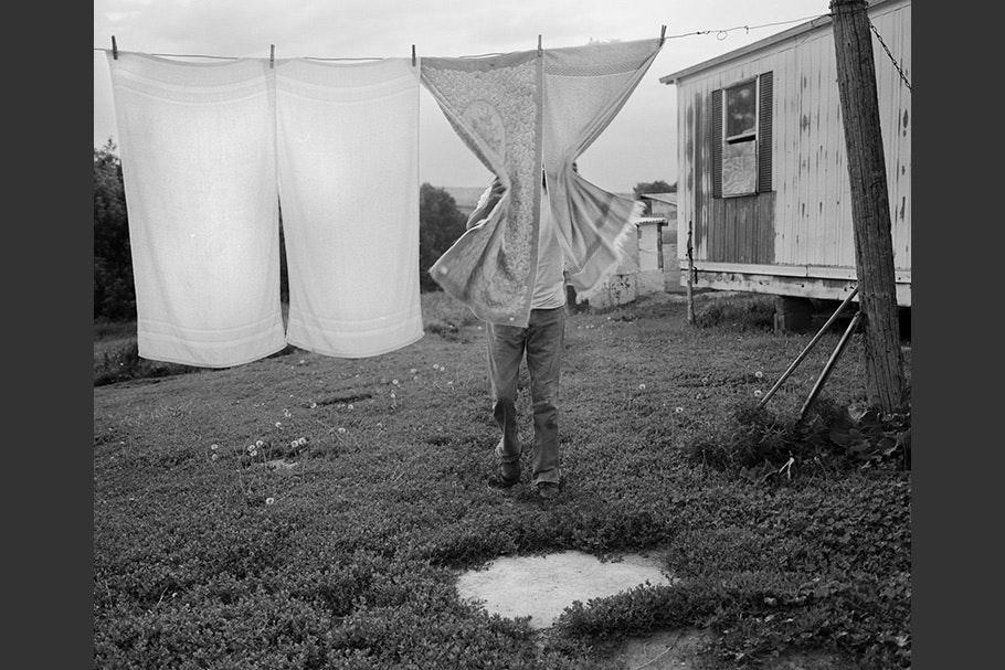 Eugene checking laundry on a clothesline.