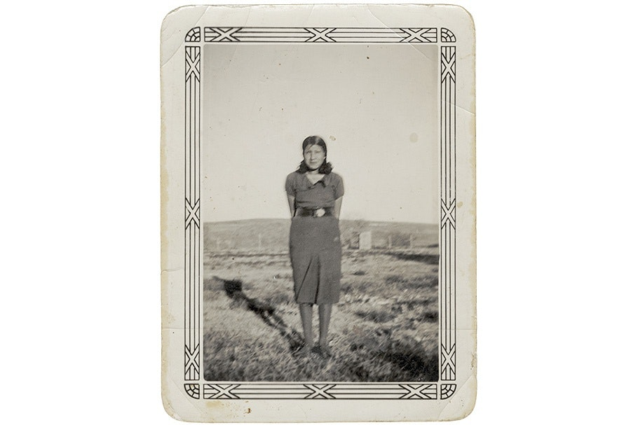 A woman standing in a field.