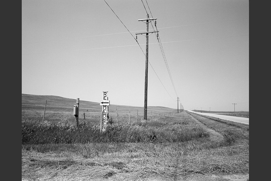 Telephone lines running along a highway.