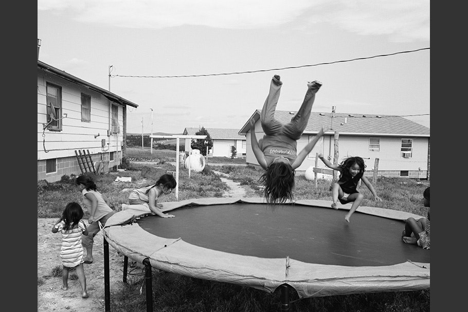 Kids playing on a trampoline.