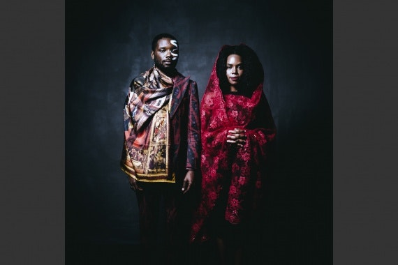 James Jean and Patrice Worthy wearing face paint and traditional clothing