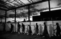 Boys exercising in a prison yard.
