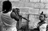 A women fixing a child's hair.