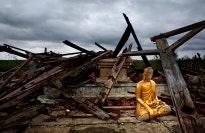 Buddha amidst rubble.