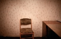 A chair in an empty room.