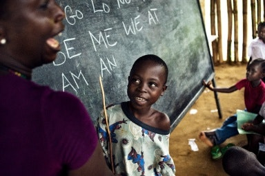 Boy at chalkboard