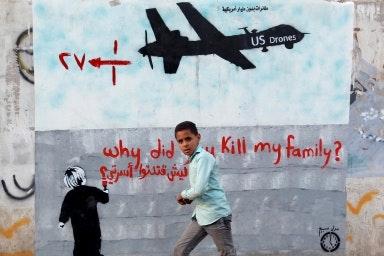 Grafitti art of a drone aircraft on a wall