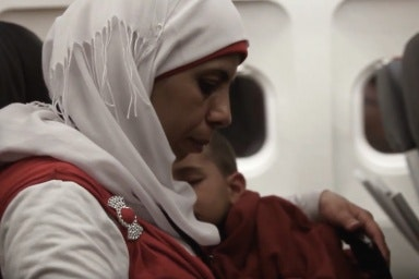 Woman and boy sitting on a plane