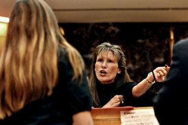 A woman facing a judge.