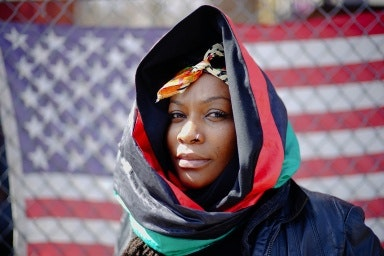 Woman in front of an American flag