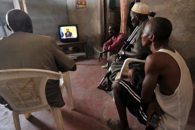 People watching a small television