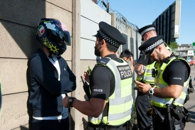 Police talking to a person wearing a helmet