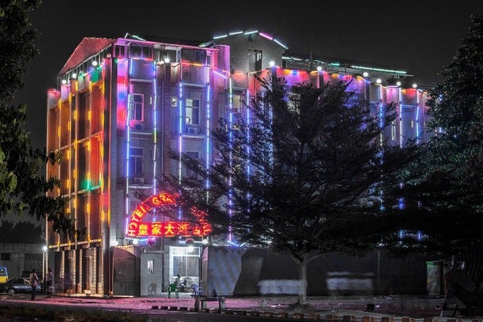 A colorful hotel at night
