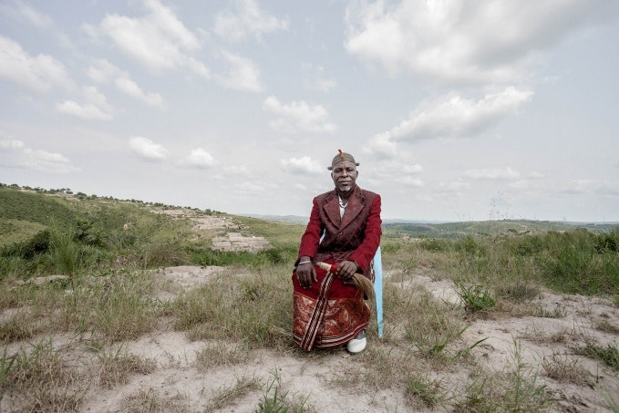 A man sitting in a chair in open land