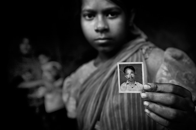 A young girl holding a picture.