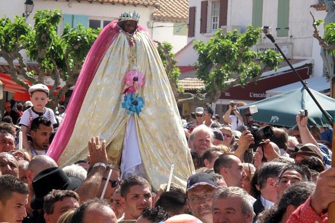 A procession of a statue