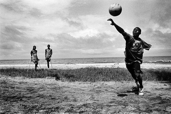 A man throwing a ball.