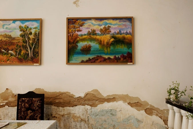 Paintings hanging on the wall.