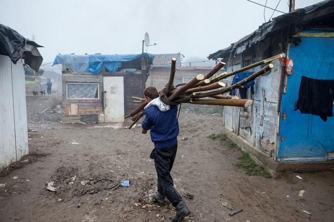 Man carrying wood