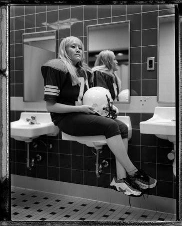 A woman sitting on a sink