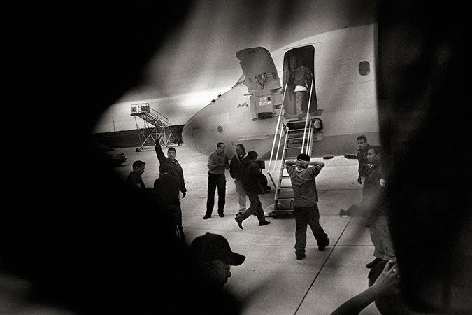 Men boarding a plane